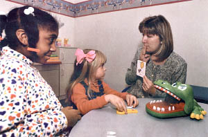 LEARNING HOW. Robin Olivier works with (from left) Rachel Singleton, 10, and Holly Jesensky, 4, at the Scottish Rite Childhood Language Center. The Center on Hermitage Road will celebrate its Fifth Anniversary Friday with a record of helping more than 1,000 children communicate better.